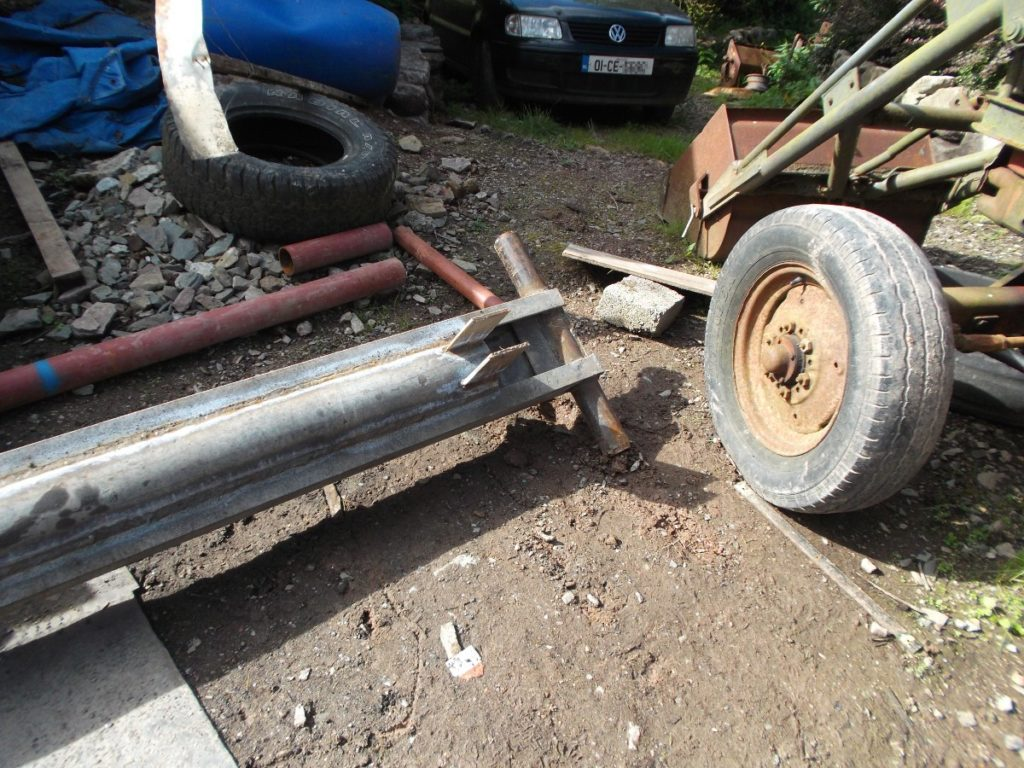 Base of mast beside tractor front wheel
